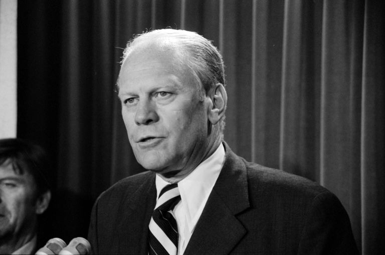 President Ford at a press conference, black and white photo.