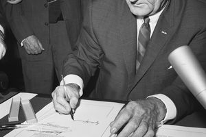 President Lyndon B. Johnson signing the Voting Rights Act