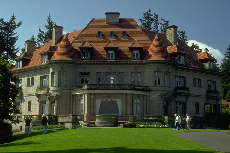 Large Stone Mansion With Red Hipped Roof Dormers And Turrets