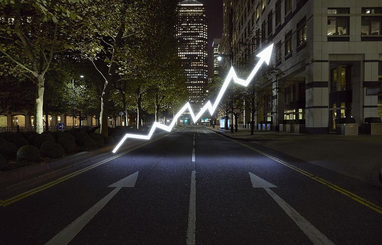 A photo illustration of a line graph in the middle of the street