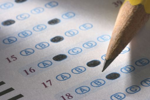 Close up of a multiple choice test with a pencil poised above the paper.