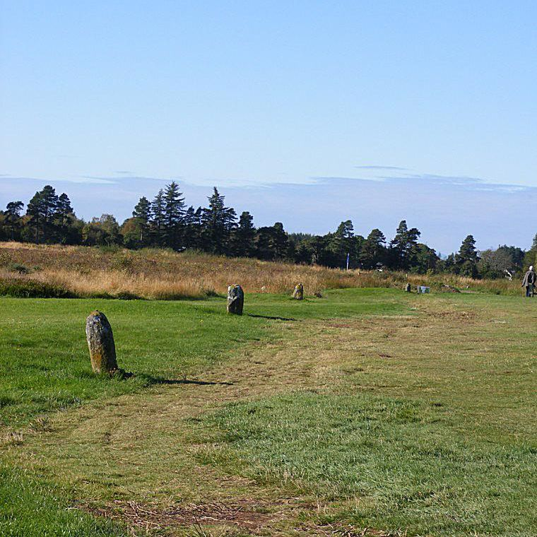 Aftermath of the Battle - The row of clan graves near the Memorial Cairn.