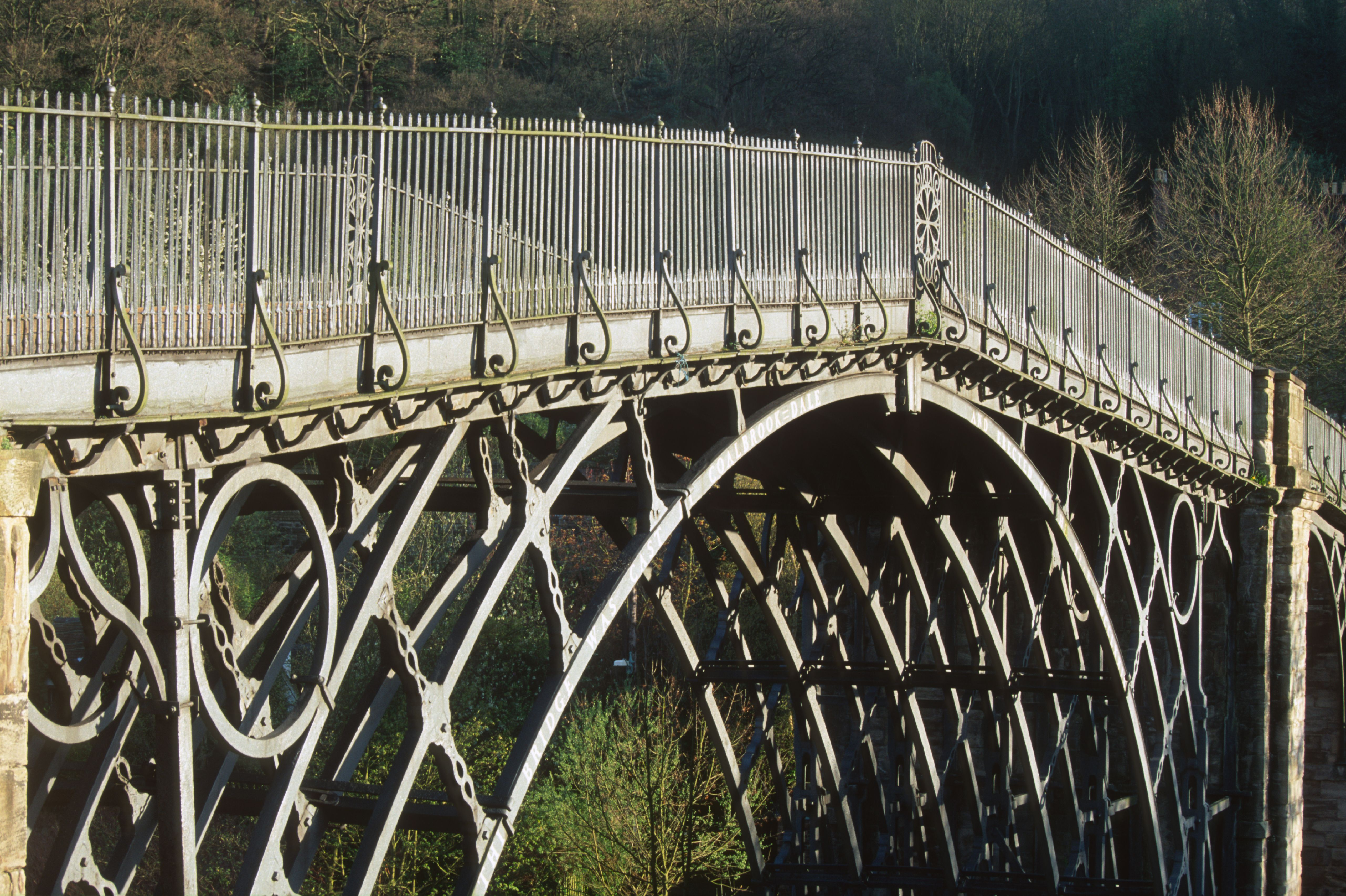 Iron arch bridge with railings on either side