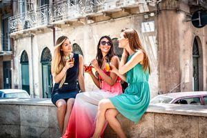 Italian women talking and sitting outside