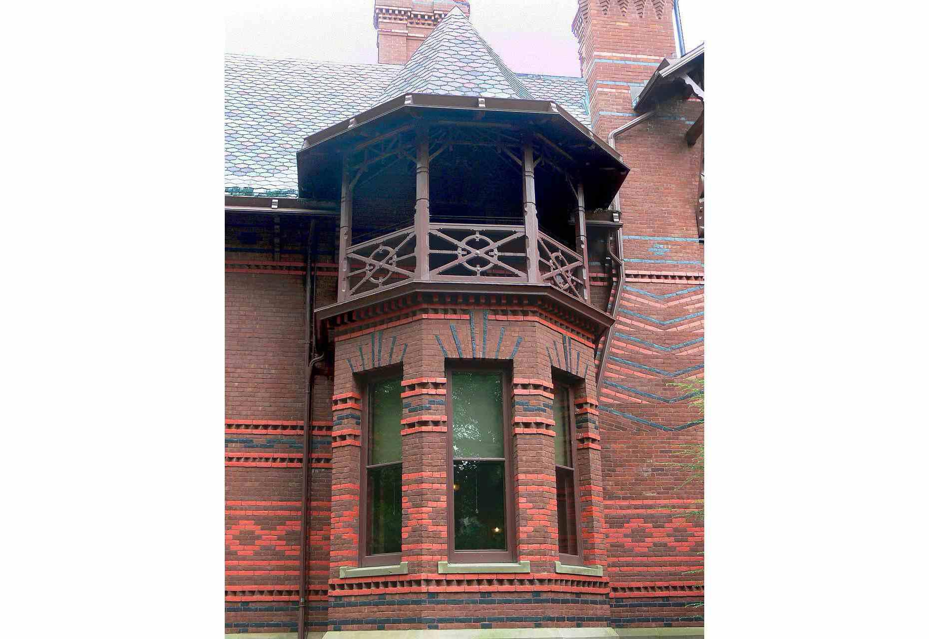Turrets and bay windows give the Mark Twain House a complicated, asymmetrical shape