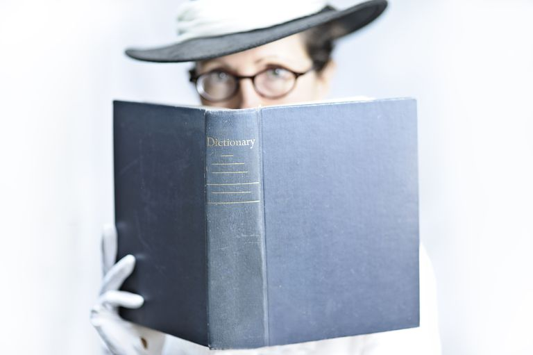 woman holding dictionary