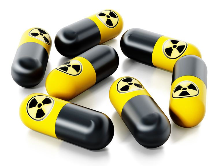 Pills with radiation logo