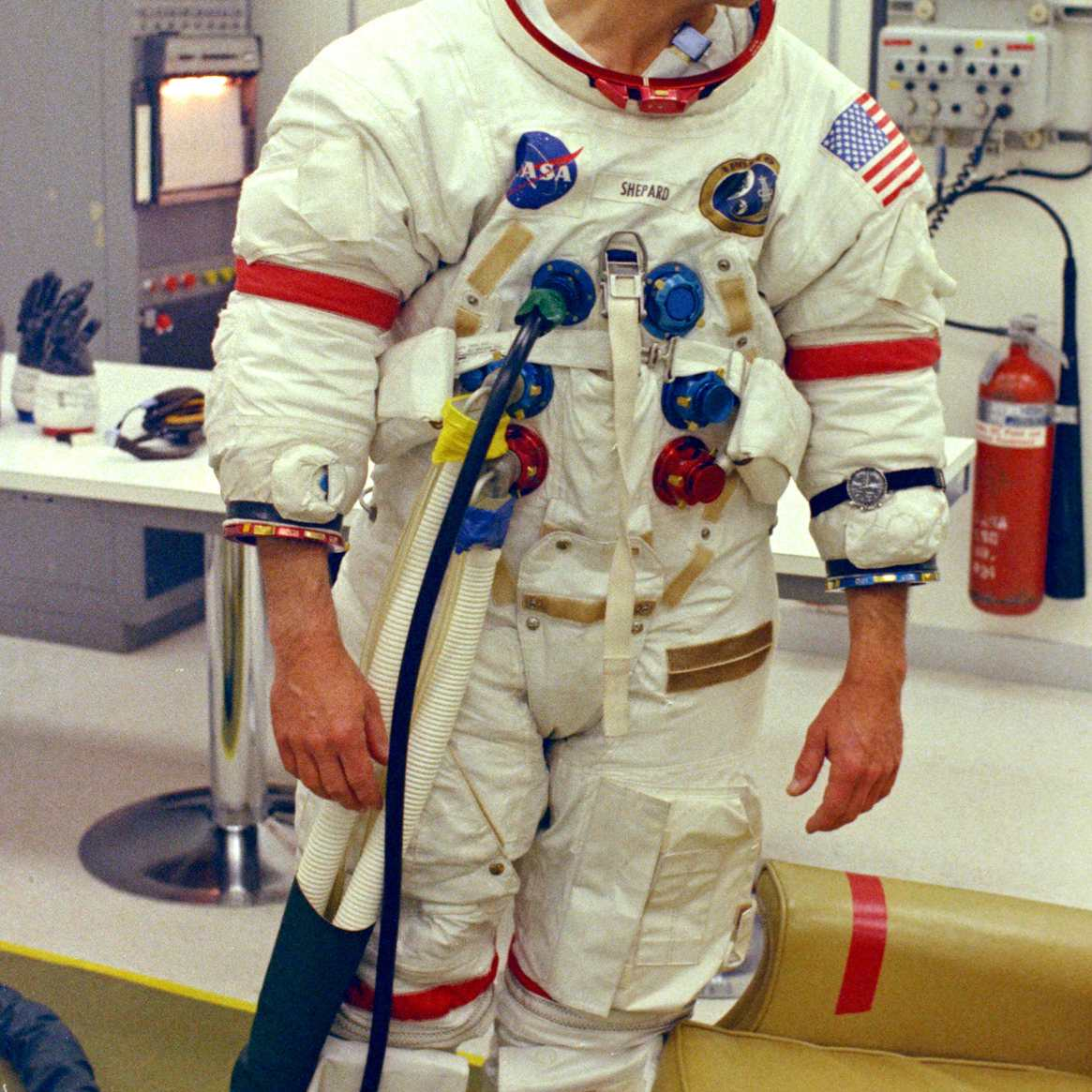 Astronaut Alan Shepard undergoes suiting up operations during Apollo 14