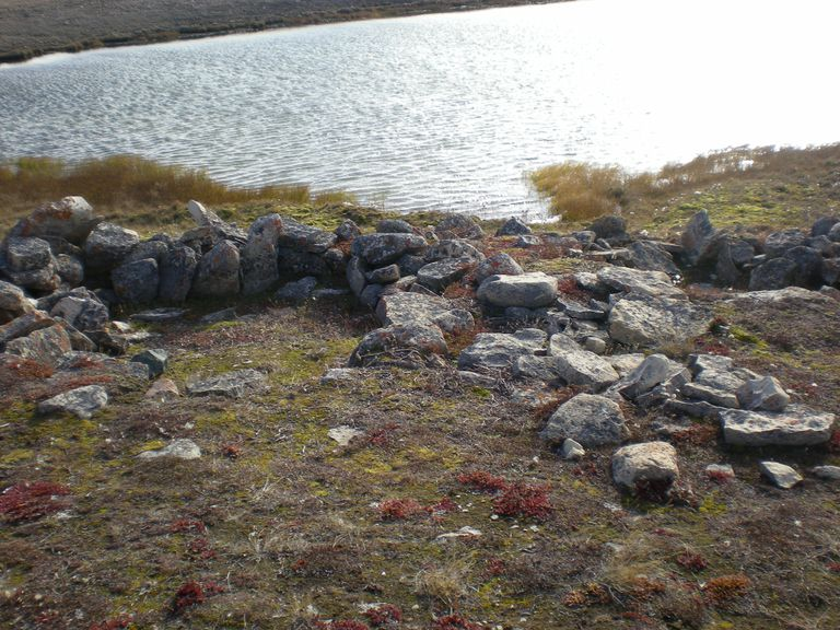 Rocks from Thule Period Camp Ring, next to a river in Nunavut, Canada