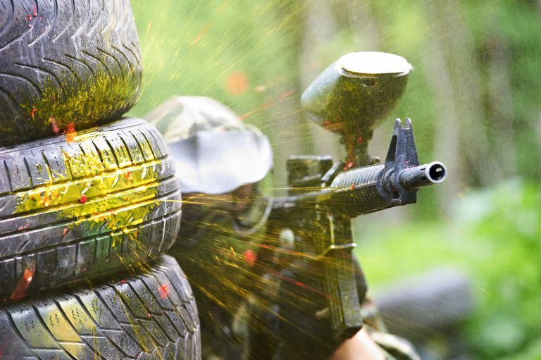 Paintball player under gunfire.