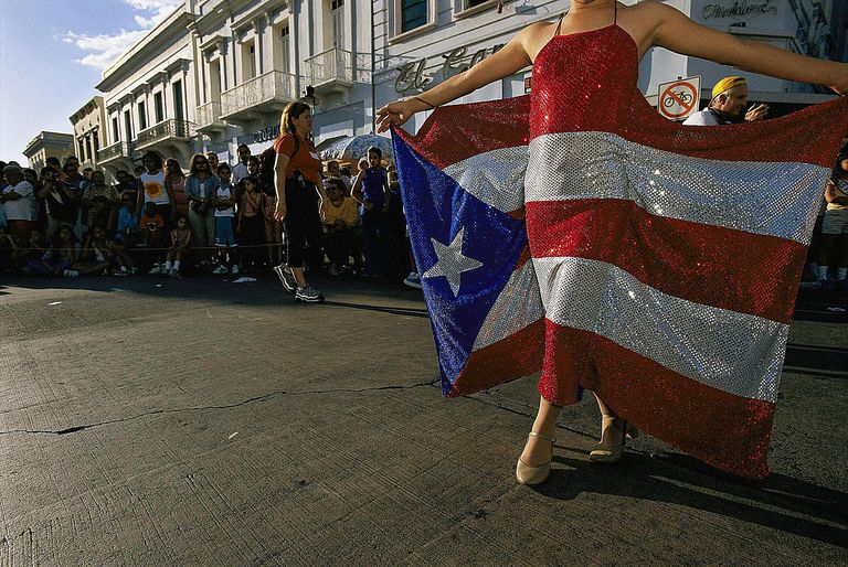Woman Holds Flag Dress at Puerto Rico Carnival