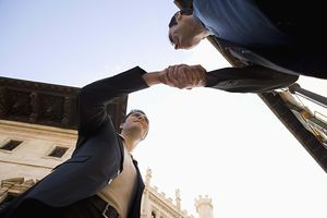 Low angle view of businessmen shaking hands