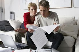 Man and woman looking through papers