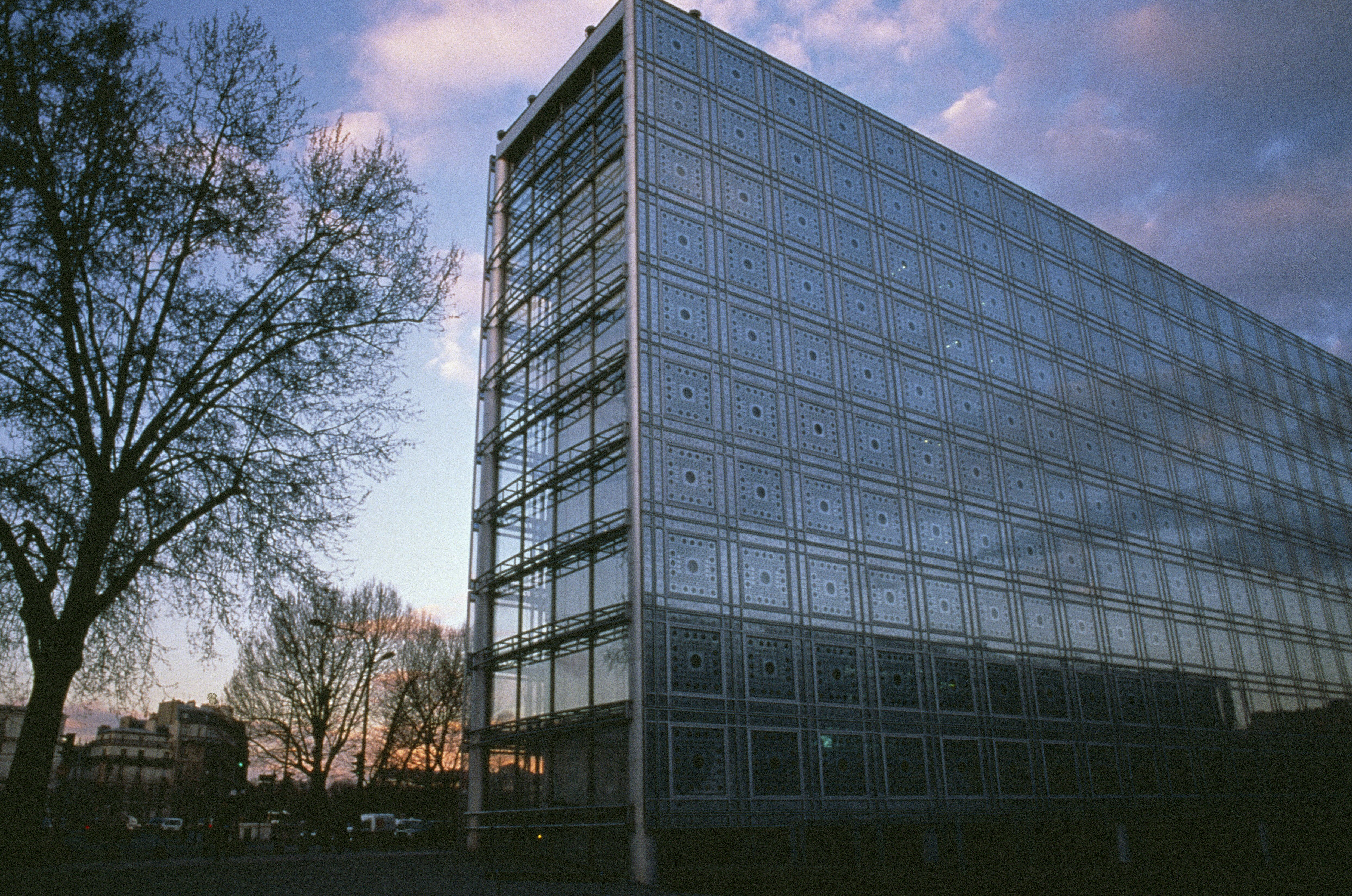 typical commercial building shape but with a lattice metal panel facade