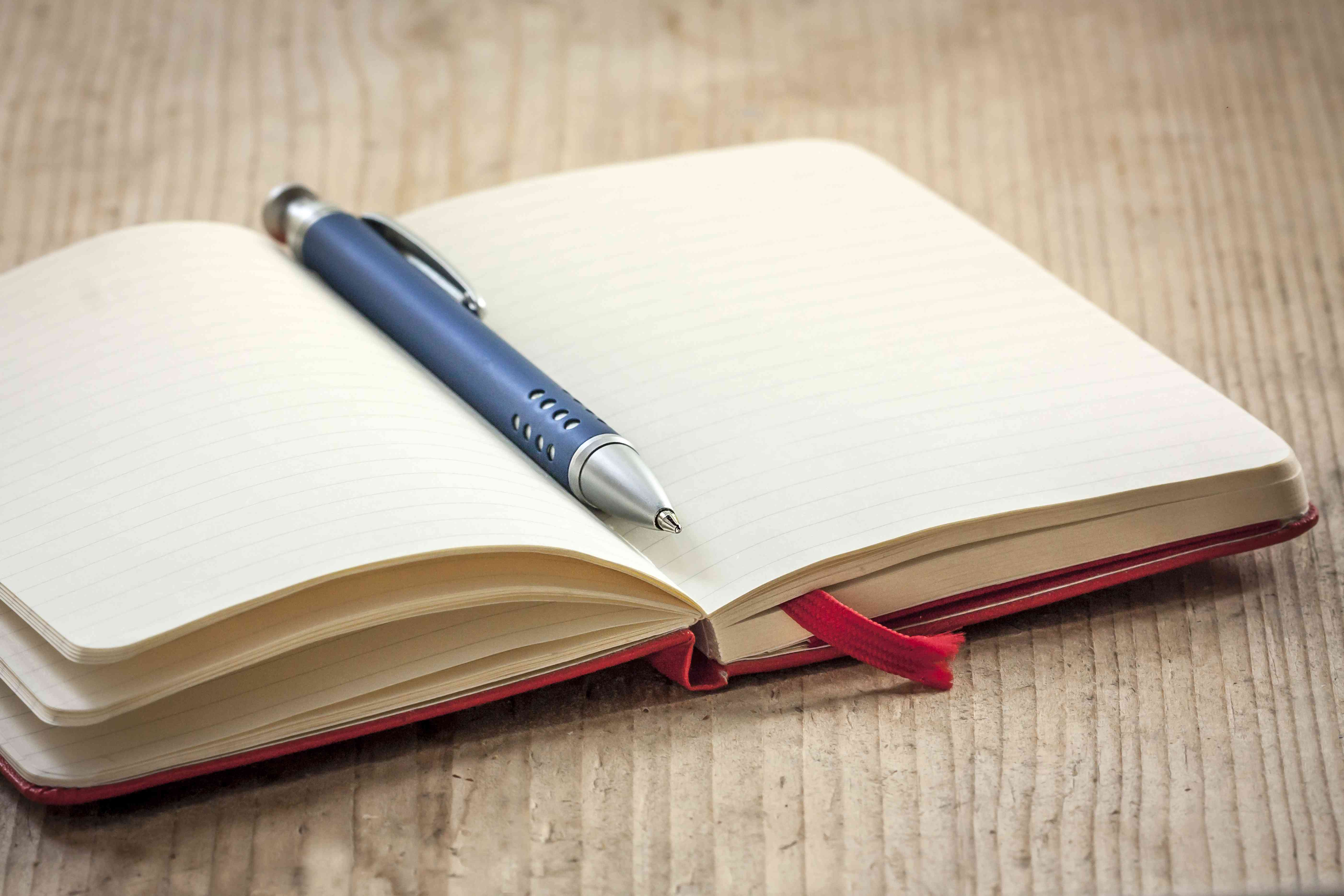 Red notebook and blue pen