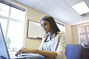 Picture of a businesswoman working on computer in an office