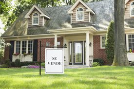 """Home for sale with """"se vende"""" sign."""