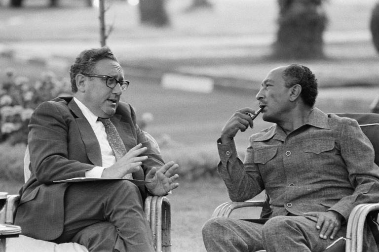 U.S. Secretary of State Henry Kissinger and Egyptian President Anwar Sadat talk during the Sinai II negotiations in 1975.