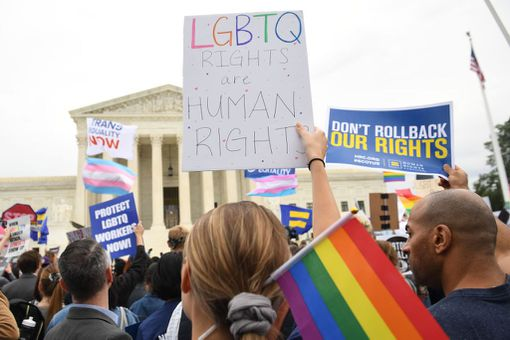Demonstrators rally for LGBT rights