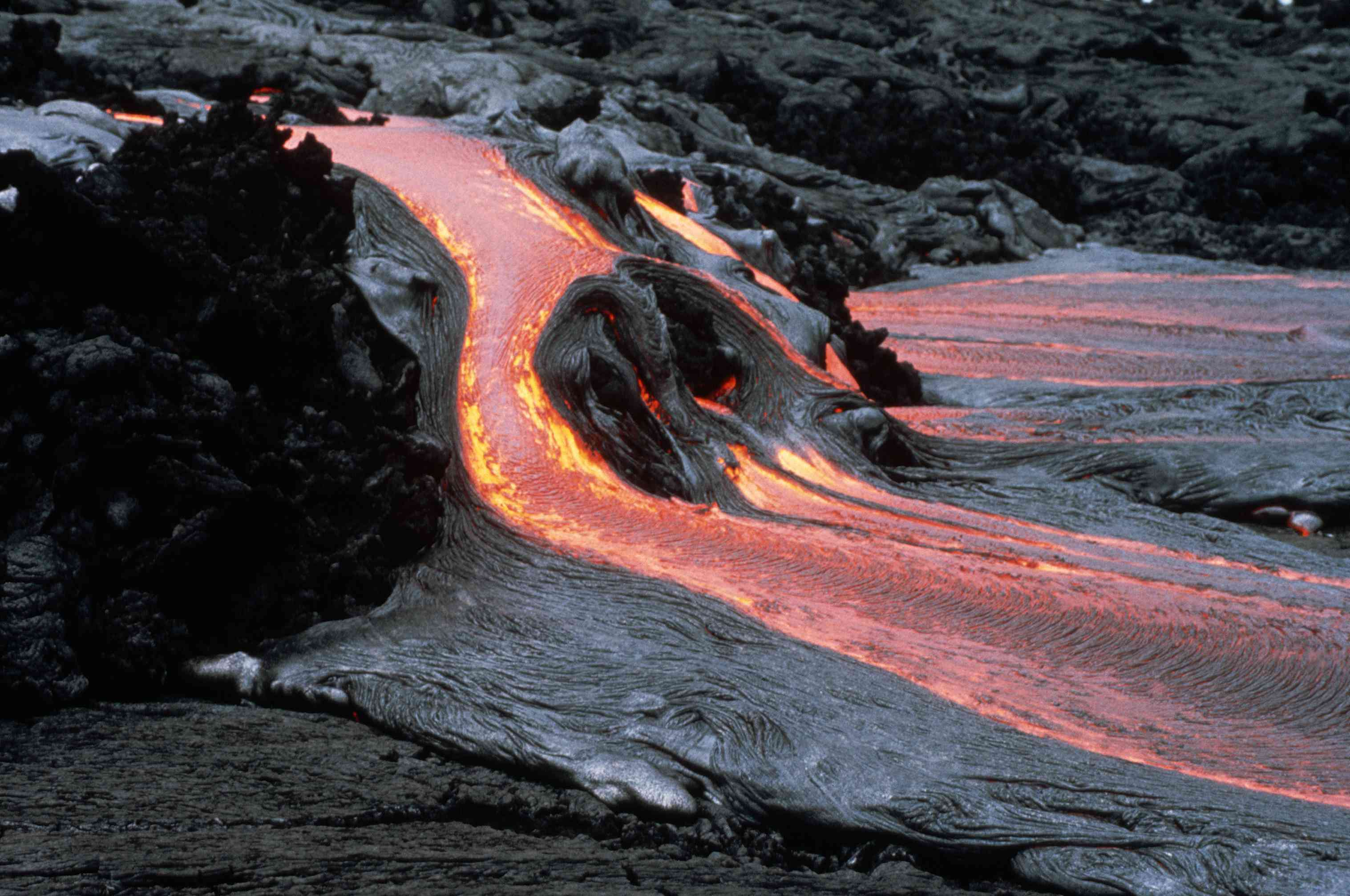 Pahoehoe lava from Mauna Ulu flows over aa on the soutwest flank of the 'Alae Crater'.