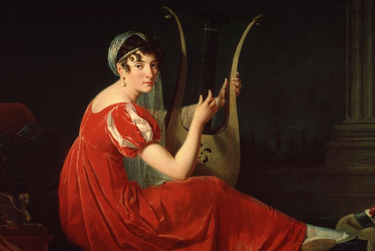A beautiful woman dressed in red plays a lyre.