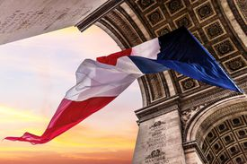 A French flag flies under the Arc de Triomphe in celebration of Armistice Day, November 11th.