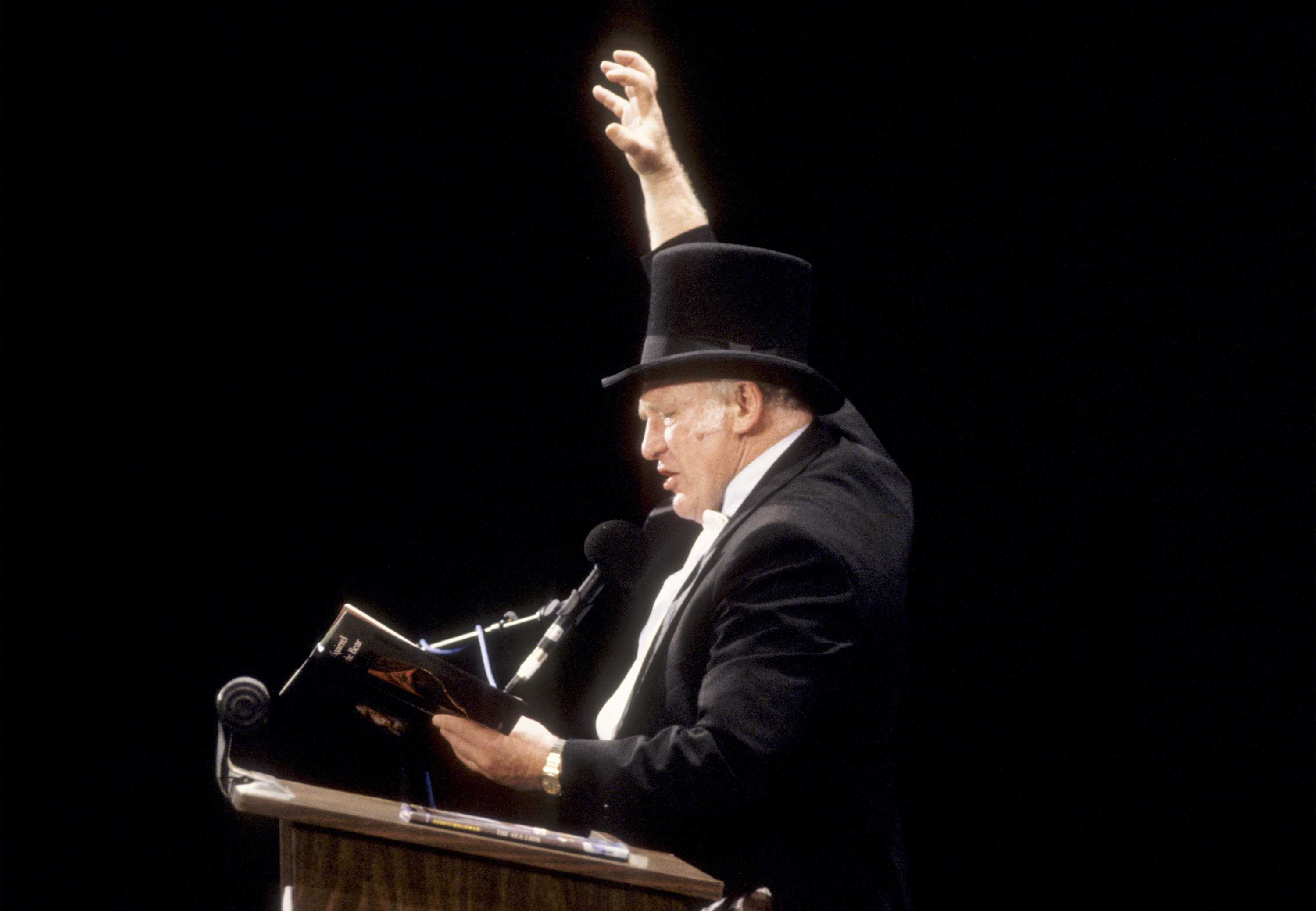 Author Ken Kesey at a lectern in 1991