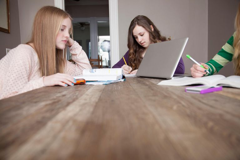 Girls sitting at table studying