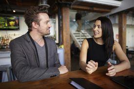 Couple having conversation in a restaurant