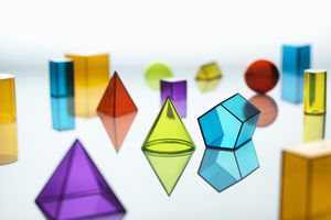 Large group of various multi-colored geometric shapes on a white field.