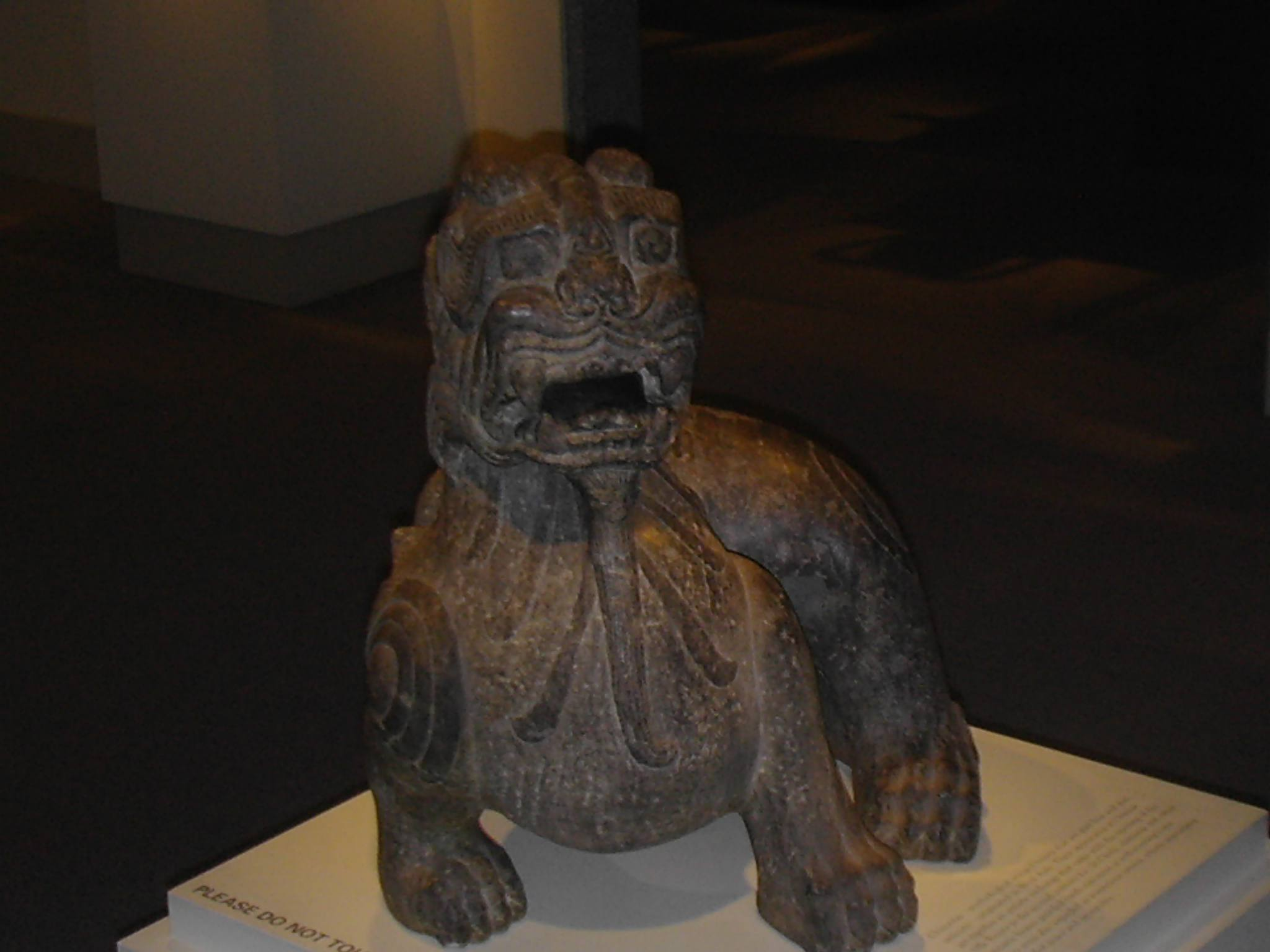 A Chinese limestone chimera statue from the Six Dynasties period on display at a museum.