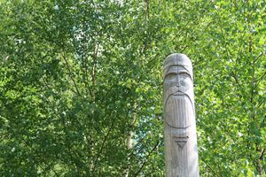 Ancient wooden slavic pagan idol of god. Heathen temple in the forest