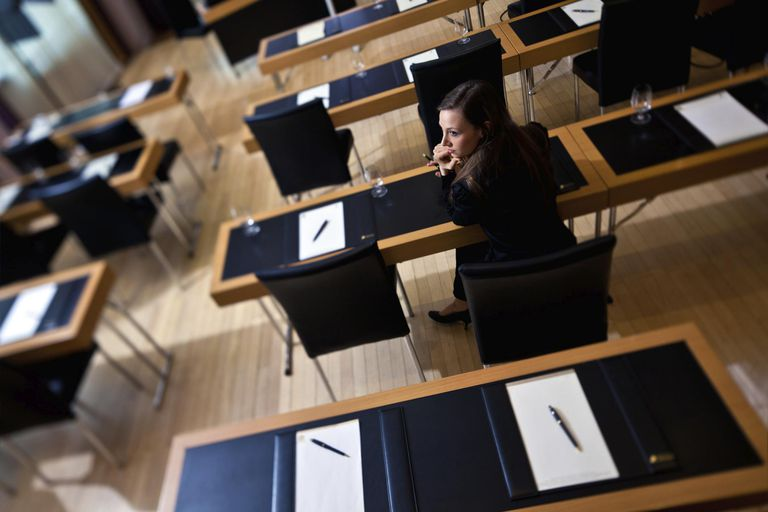 Young businesswoman in empty classroom