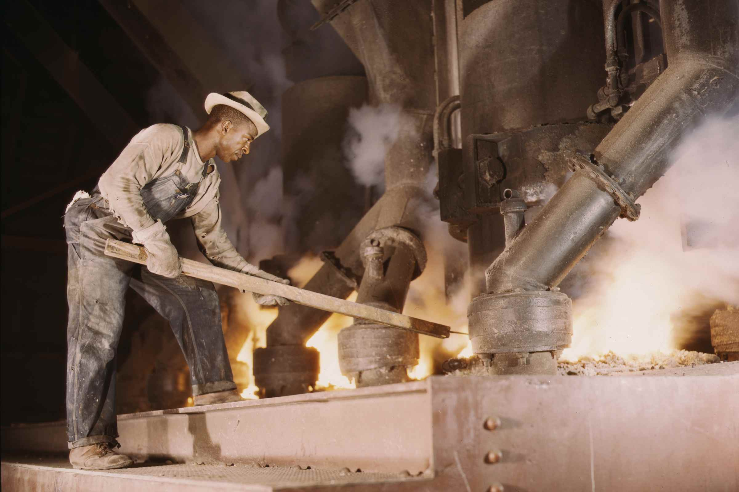 Man working at a smelting furnace