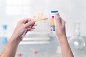 Litmus strips measuring an acid
