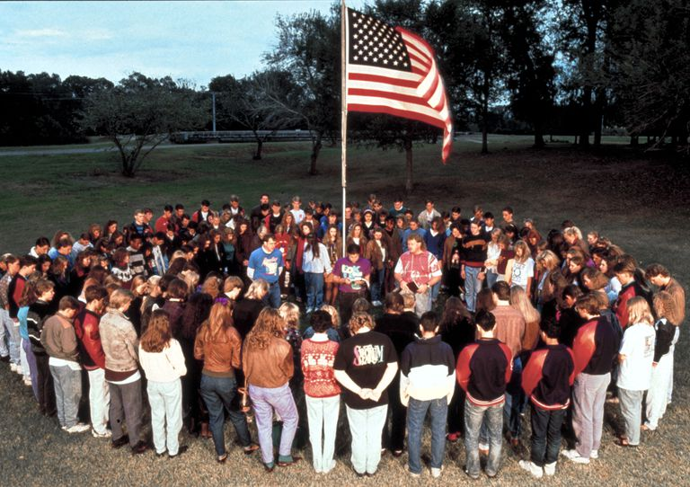 prayer circle around American flag