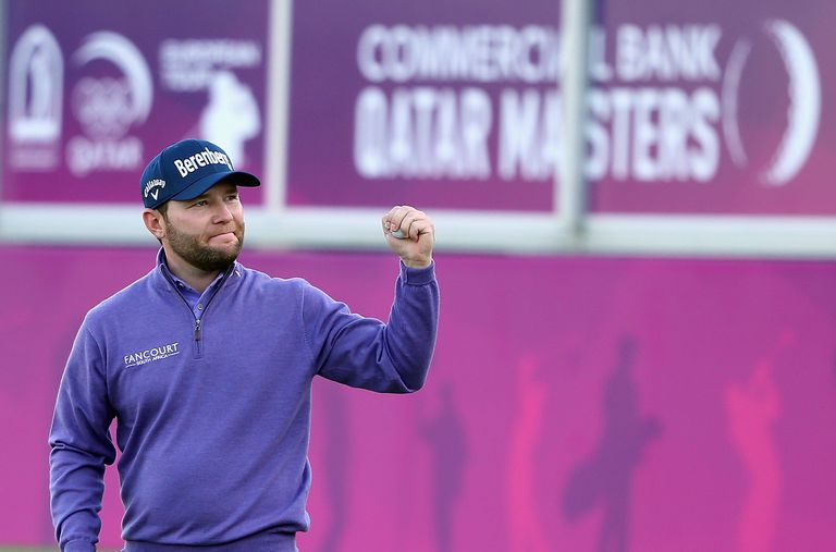 Branden Grace of South Africa celebrates on the 18th green after winning the Commercial Bank Qatar Masters at Doha Golf Club on January 30, 2016