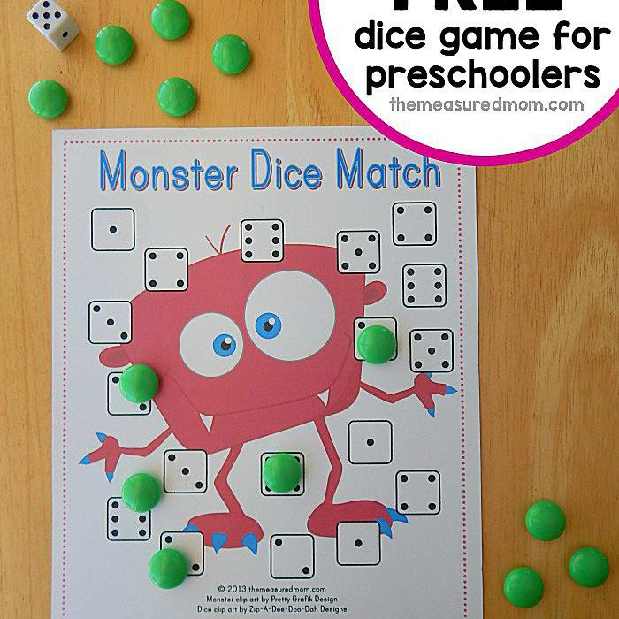 A printable Halloween game with dice and candy.