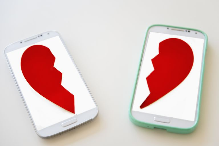 two halves of a broken heart on cell phone