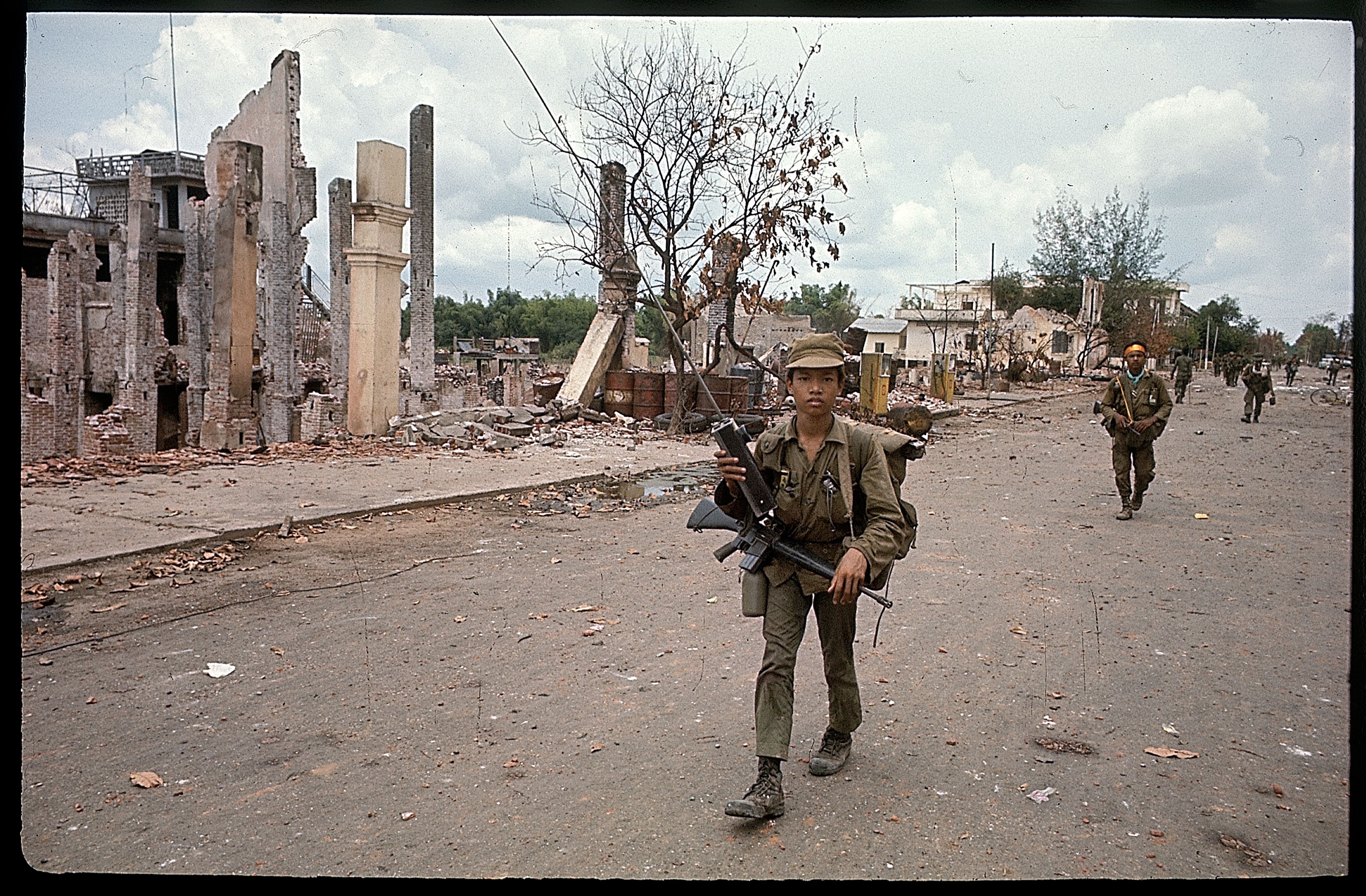 Refugees flee the Tan Son Nhut area after a Viet Cong attack on May 6, 1968.