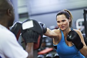 woman training in boxing gym