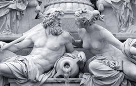 statue of a Zeus and woman