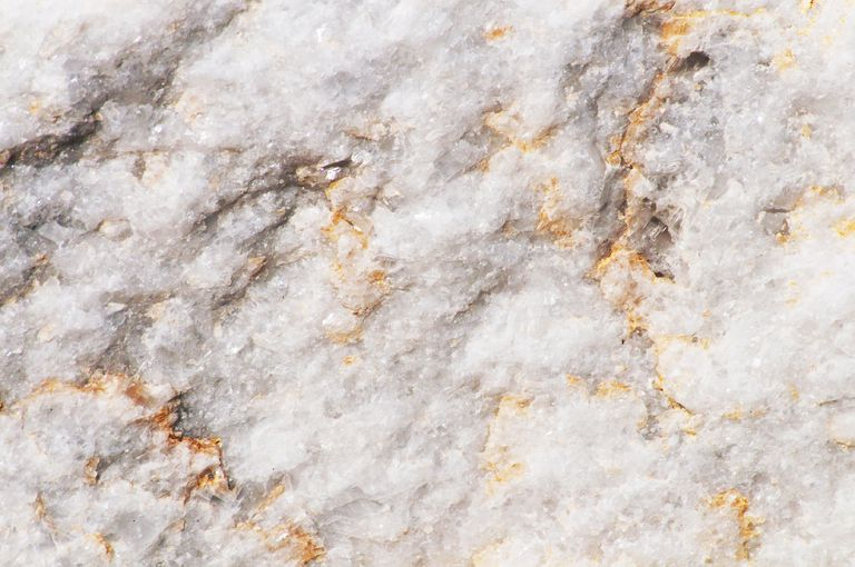Marble is a crystalline metamorphic rock. In its pure form, it's white.