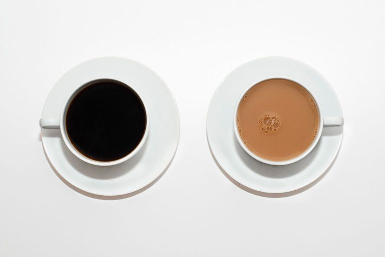 Two cups of coffee, one with milk and one black