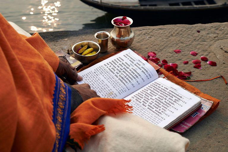 A monk reads the Mahabarata by the river Ganges