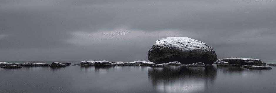 Widescreen wallpaper of rocks in a body of wallpaper