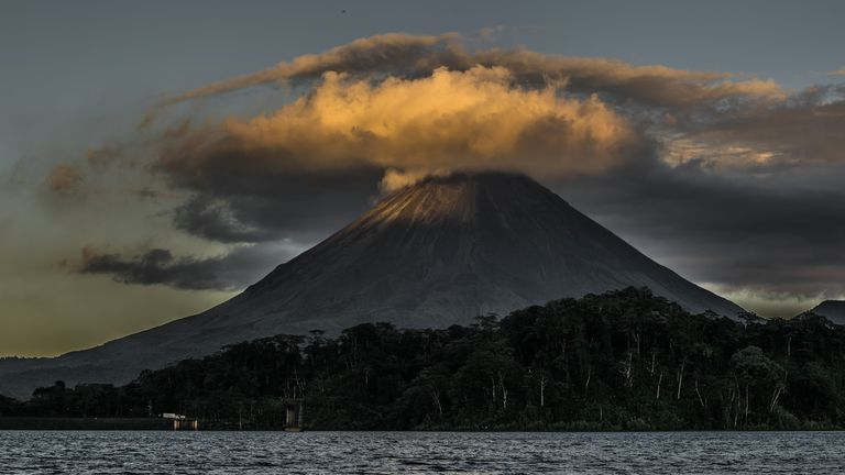 Volcano with clouds swirling above ominously.
