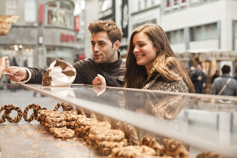 Germany, Cologne, young couple in the city at bakery