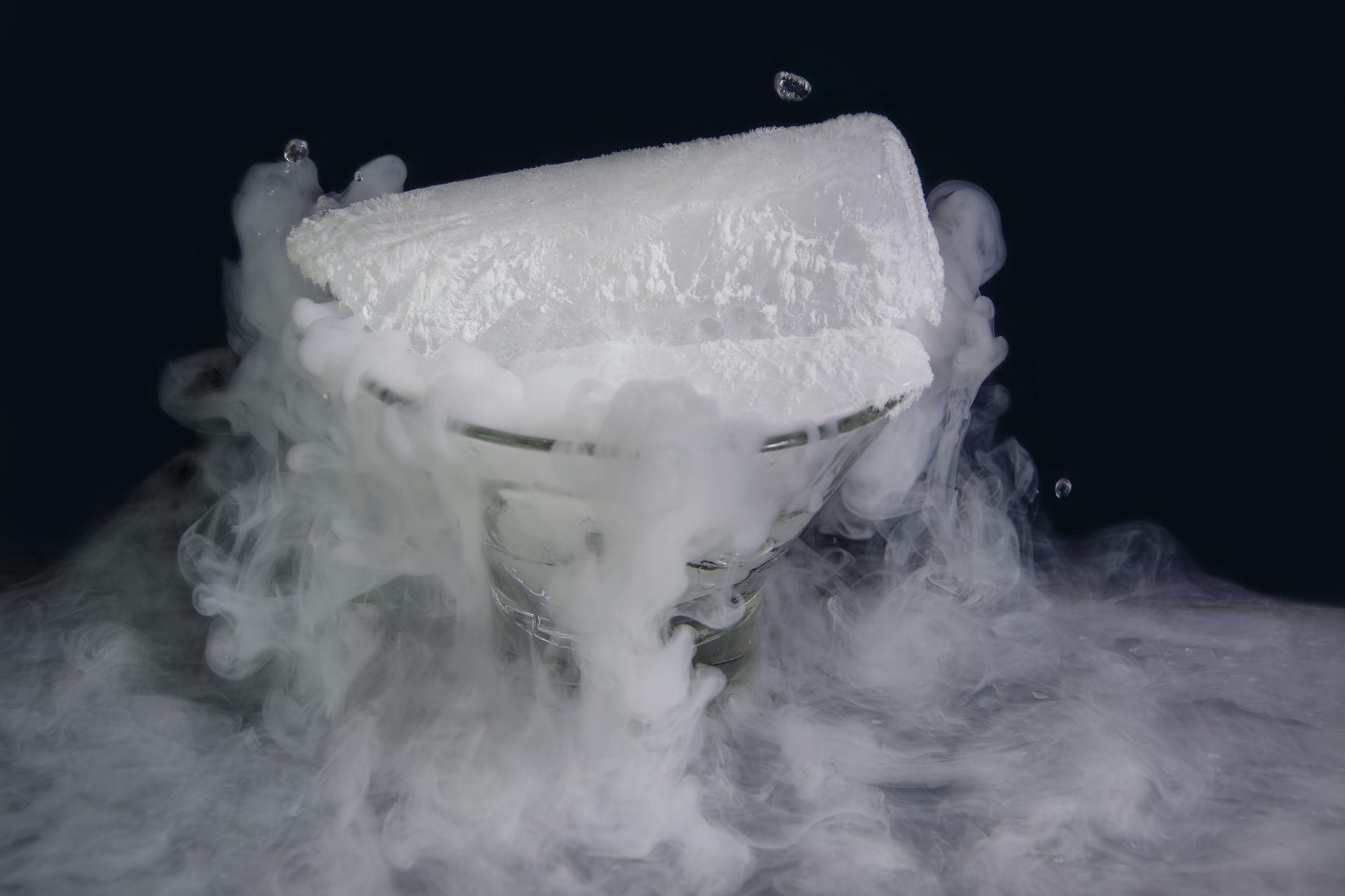 Dry ice smoking with vapor on dark background