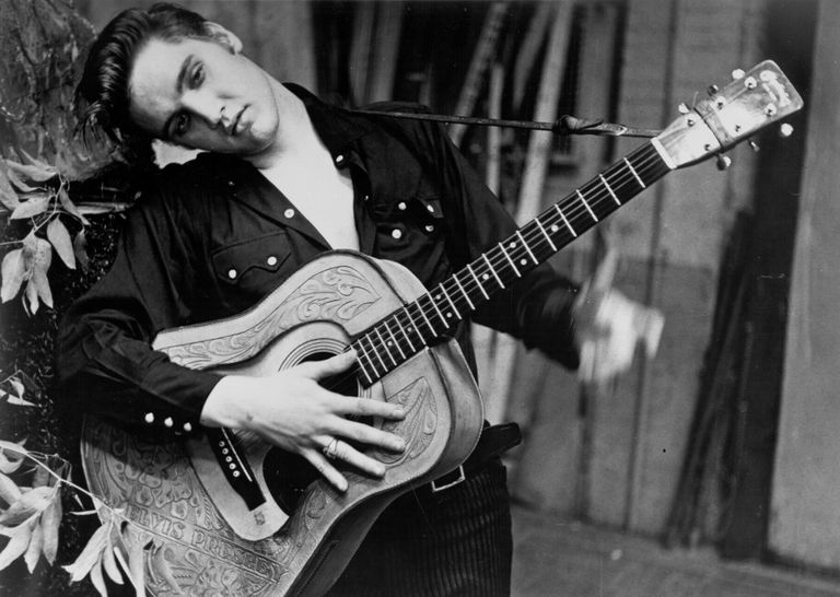 Elvis Presley portrait with an acoustic guitar